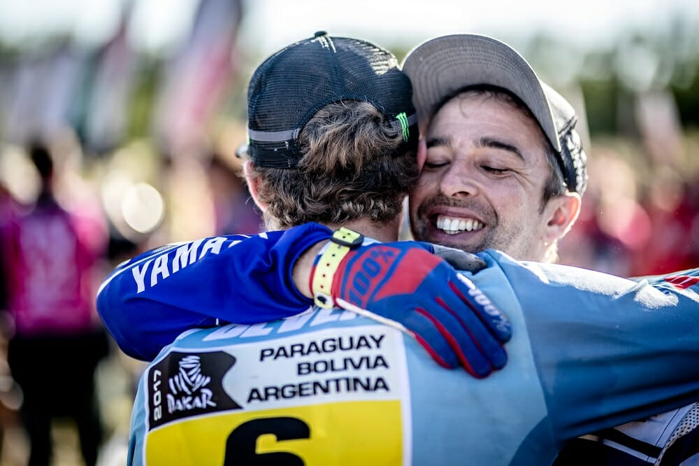 Helder Rodrigues congratulates his Factory Yamaha teammate Adrien Van Beveren after reaching the finish.