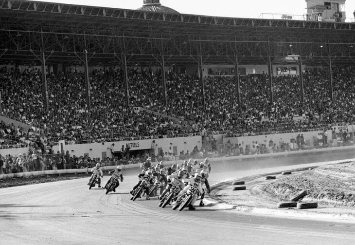 Gene Romero leading the pack into the first turn in front of a packed grandstands at the 1969 Sacramento Mile.