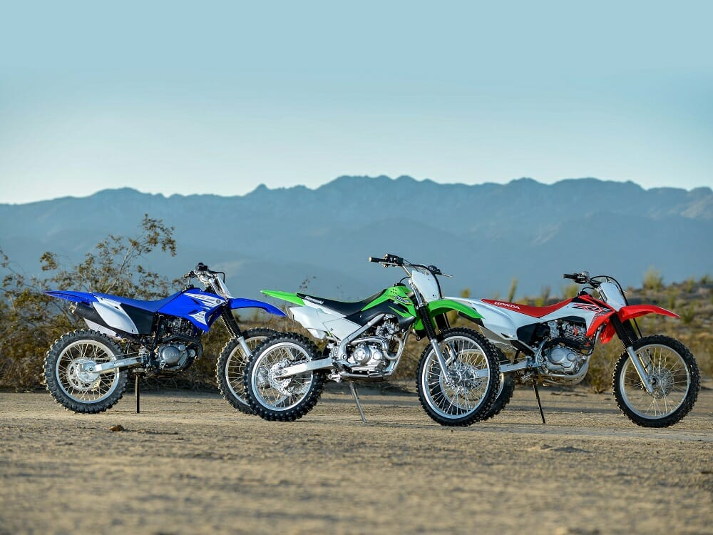 Ready for action: (Left to right) Yamaha TTR230, Kawasaki KLX140G and Honda CRF230F.