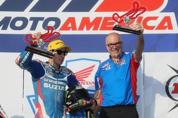 Yoshimura Suzuki's Roger Hayden led every lap of Saturday's Race 1 en route to his third MotoAmerica Superbike victory of the season. Here he celebrates on the podium with team technician Darin Marshall. (Photo by Brian J. Nelson)
