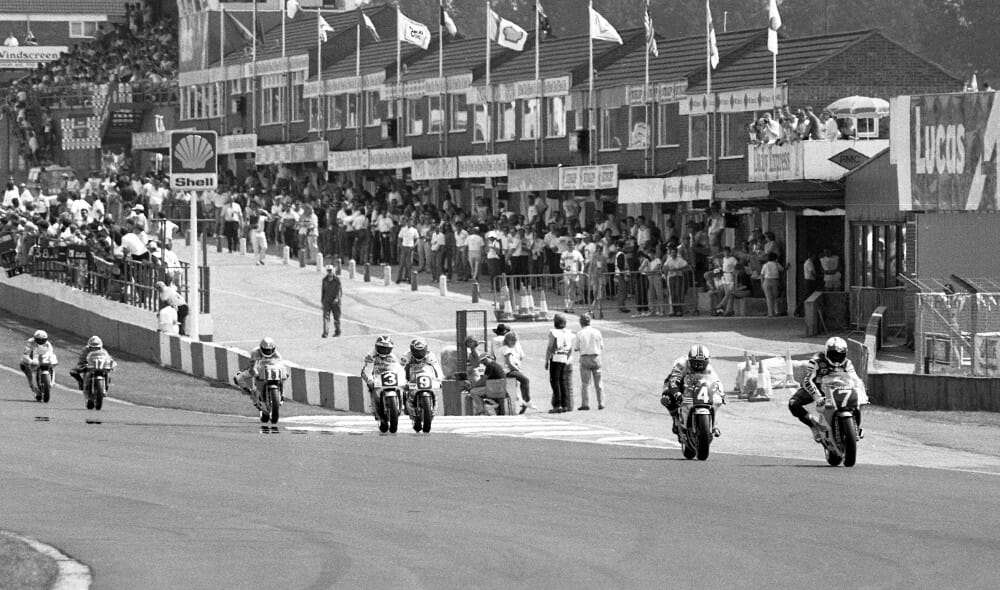 Luca Cadalora, on the Marlboro-Yamaha YZR250, leads the British 250 Grand Prix in front of a jam-packed pit lane at Doninton Park in August of 1988. (Photo by Henny Ray Abrams)