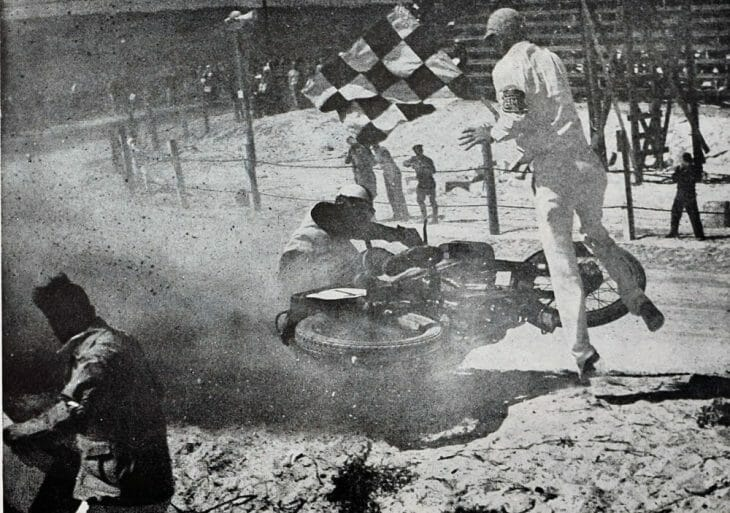 Starter Jim Davis is hit at the finish of the 1948 Daytona 100-Mile Amatuer race by Don Evans. (Photo by C.W. Galbreath)