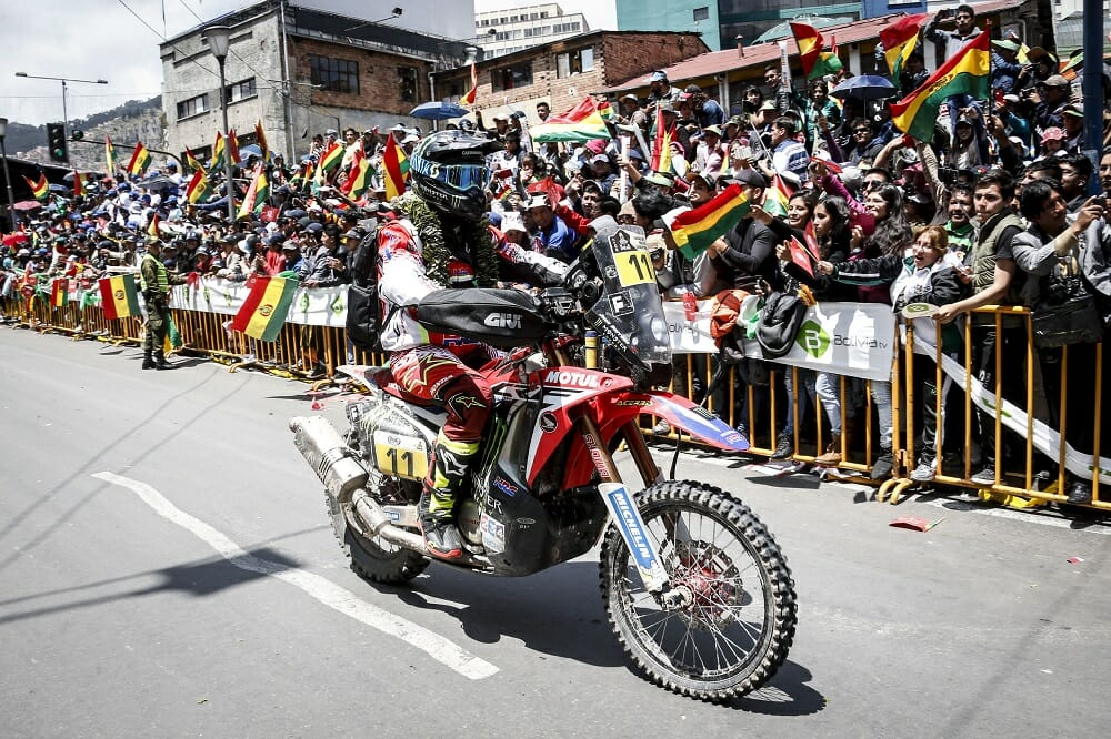 Monster Energy Honda's Joan Barreda is welcomed by passionate Bolivian fans. Despite winning four stages, Barreda couldn't overcome a one-hour penalty levied on the entire HRC team, and had to settle for fifth place.