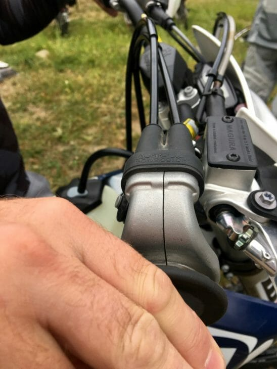 Two throttle cables on a two-stroke. It's weird, but it works.