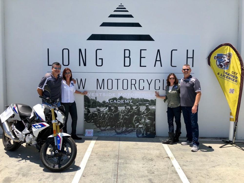 Long Beach BMW Motorcycles co-owners Charles Berthon and David Lindahl with Westside Motorcycle Academy co-owners Erika Willhite and Amanda Cunningham. (From left: Berthon, Willhite, Cunningham and Lindahl)