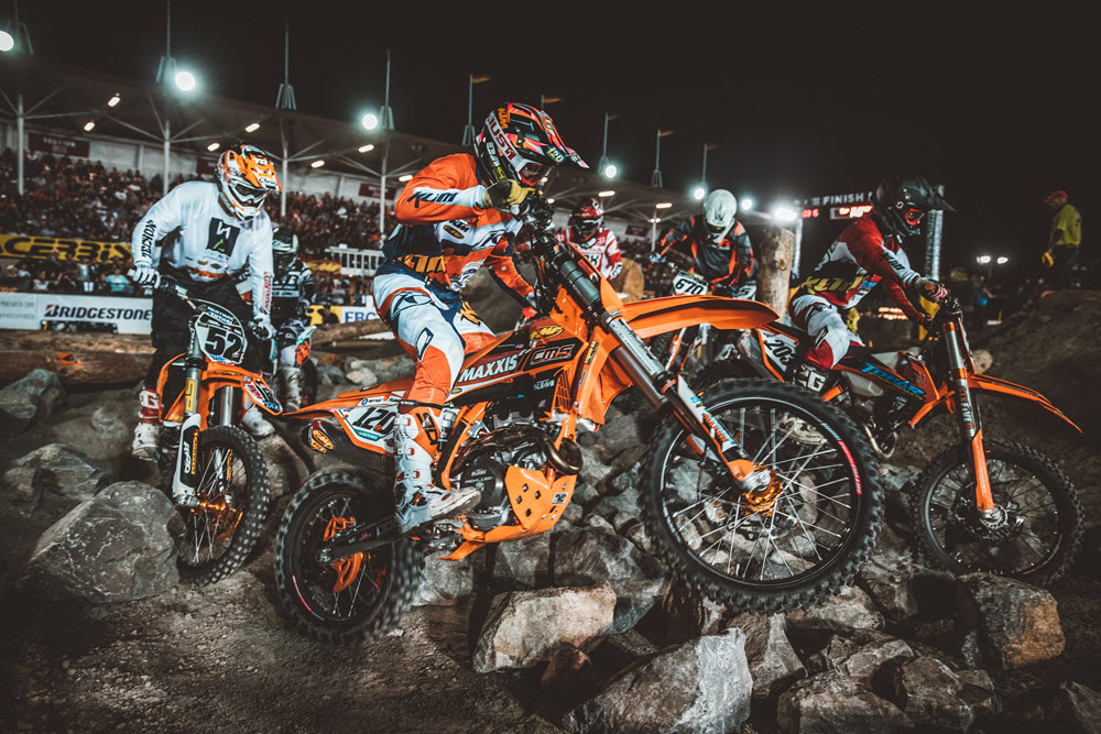 This is just a typical rock turn in EnduroCross with several riders battling for position. Cooper Abbott (120) does his best to move around the outside. Photo: Tanner Yeager.