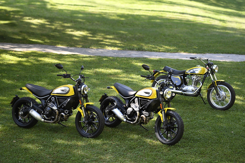 Three generations of Scrambler, starting with the OG of 1962 in the background to the present day at the front.