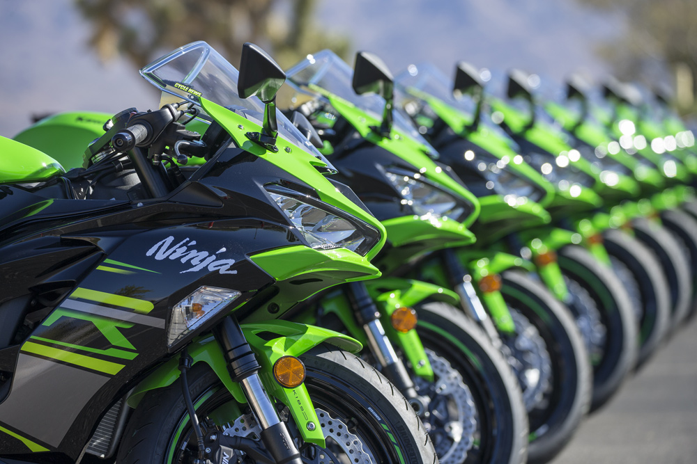 A line of Ninjas: The press could have any bike they liked, as long as it was green. The LED lights make the 600 look rather mean.