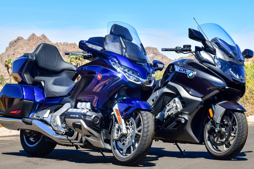 Picture a clear desert road, your perfect partner on the back and either of these two motorcycles beneath you. Sounds good, right? But which one is better if you want to mash those miles? We did the dirty work for you to find out
