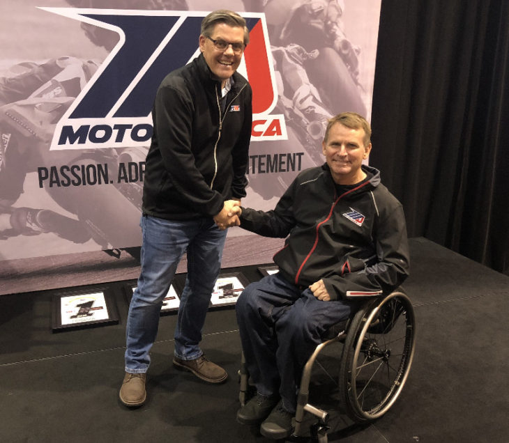 AMA President and CEO Rob Dingman and MotoAmerica President Wayne Rainey shake on a deal that will keep the AMA Superbike Championship and MotoAmerica together through the 2029 season.