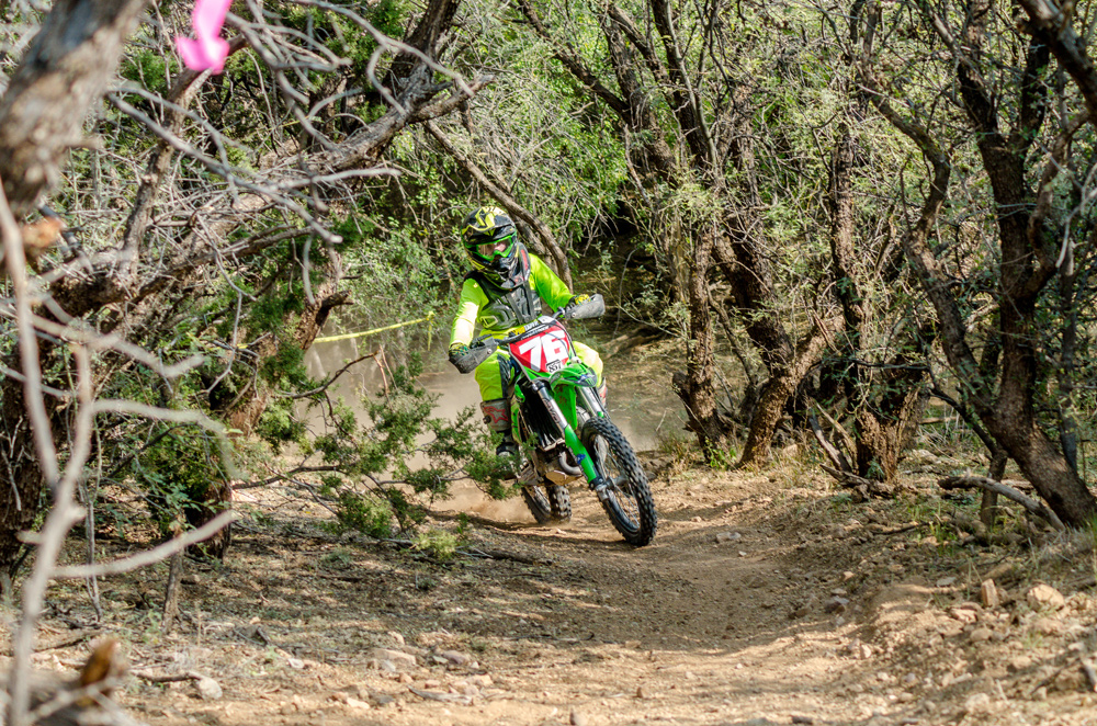Chase Haynes climbs one of the many hills of the Supermini race