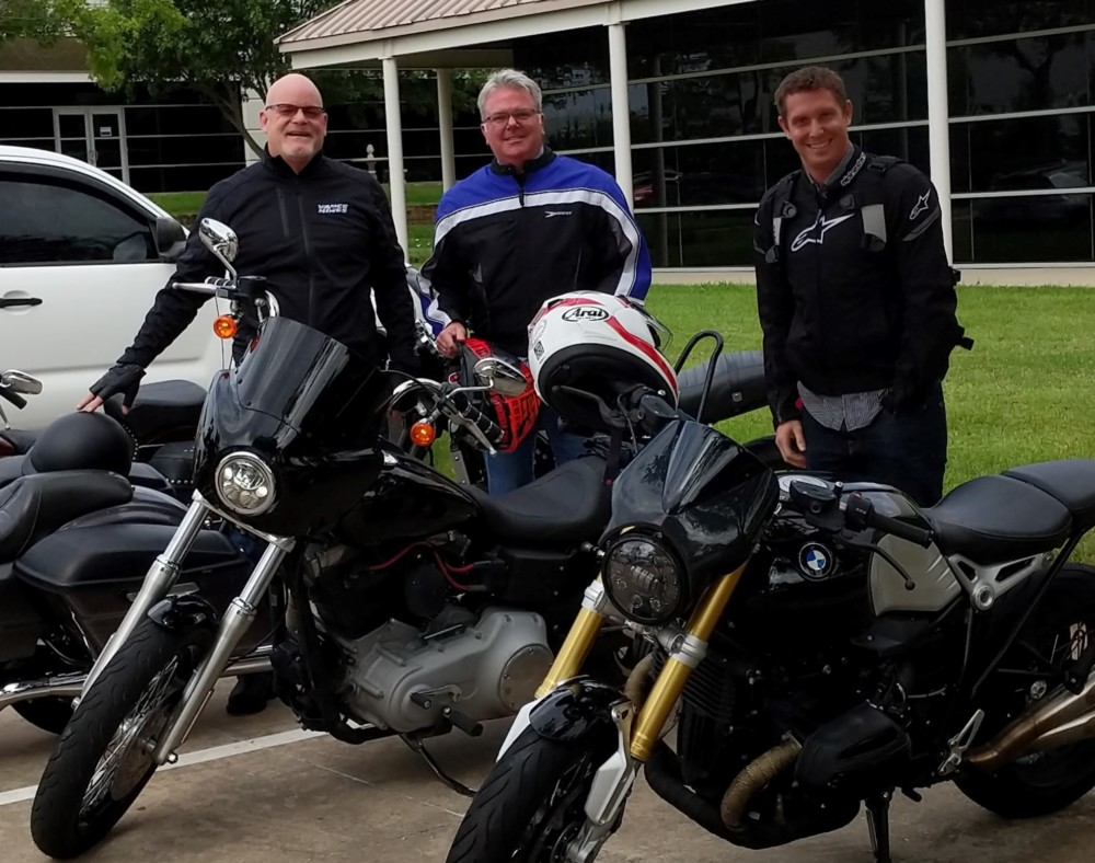 Best job interview ever. Hugh Charvat, new CEO of Motorsport Aftermarket Group (center), joined Board Member Mike Buettner (left) and J&P Cycles President Zach Parham for a ride in Dallas during his interview process.