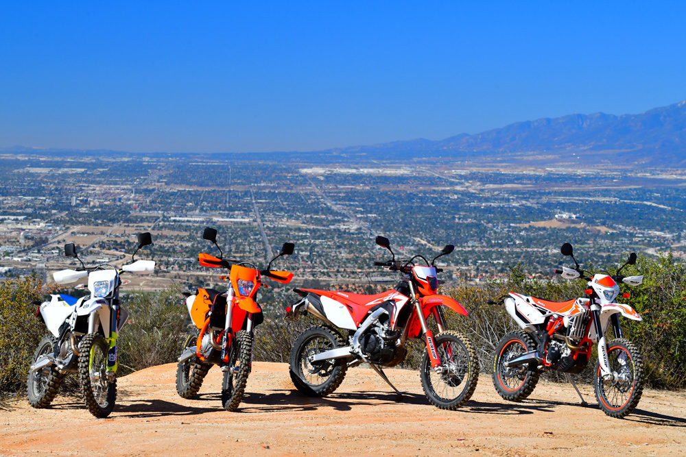 The (L-R) Husqvarna, KTM, Honda and Beta all in their element—far away from civilization.