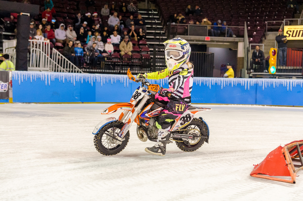 Cassie Fairfield races around the ice on her specialized KTM 65cc.