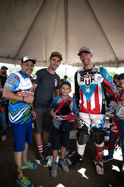 Travis Pastrana and Ryan Sipes met many local families on their relief trip to Puerto Rico in December 2018. Photo by Scooter Cooper