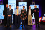 """The AMA Motorcycle Hall of Fame Class of 2018 (l-r): Gary Davis, Nicky Hayden family representative Tommy Hayden, Terry Cunningham, Skip Eaken's widow, Linda Eaken, Clifford """"Corky"""" Keener and Mary McGee. Photo by Jeff Kardas"""
