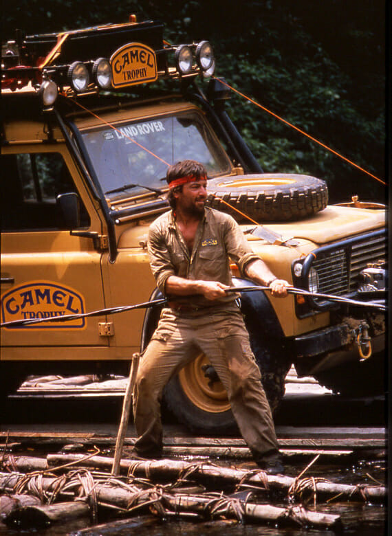 Beppe Gualini also competed with distinction on four wheels, with a record of 15 Camel Trophy starts, widely regarded as the toughest race ever conceived for cars. Here, Gualini does his best to cross a river in Borneo with a handmade wooden raft.
