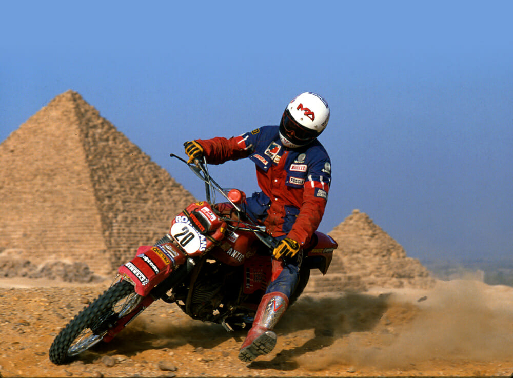 Beppe Gualini in front of the Great Pyramids after claiming victory in the 125cc class of the Pharaohs Rally, 1982. This shot landed on the front cover of many magazines in Italy and made Gualini a rally star almost overnight.