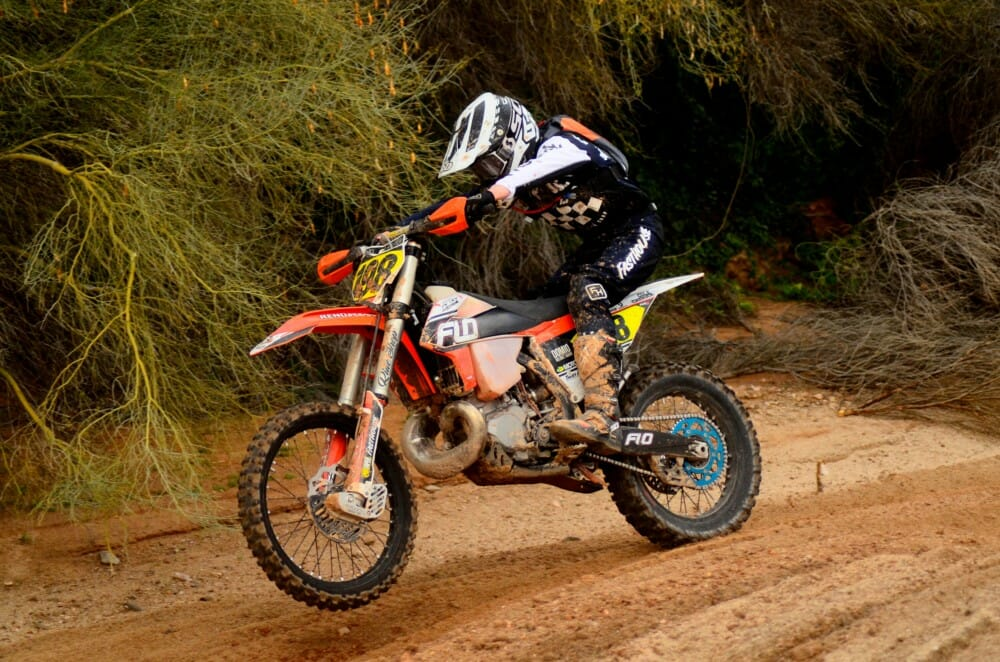 Cole Cherick (250A) leaps through the sand whoops.