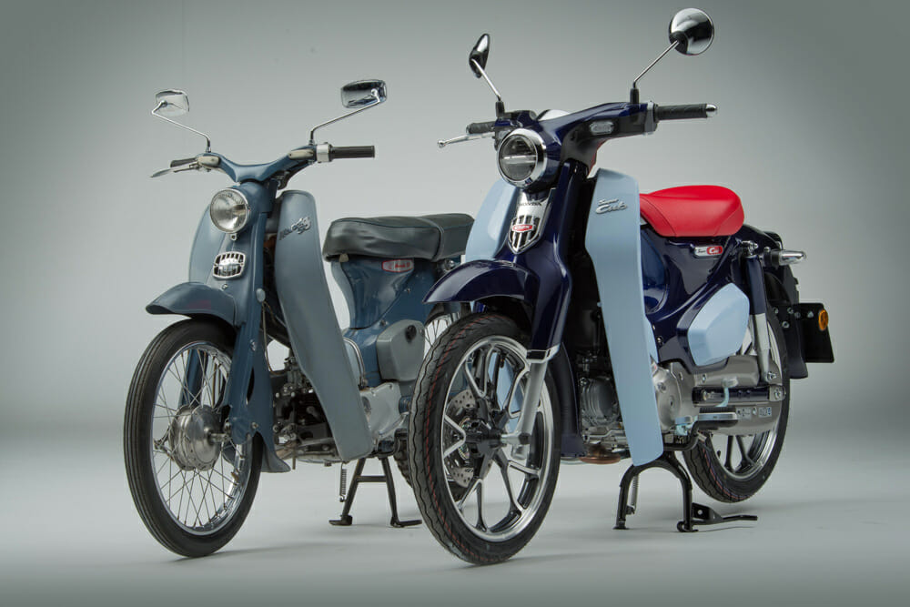 The 1961 Honda Cub on left and the 2018 Honda Cub.