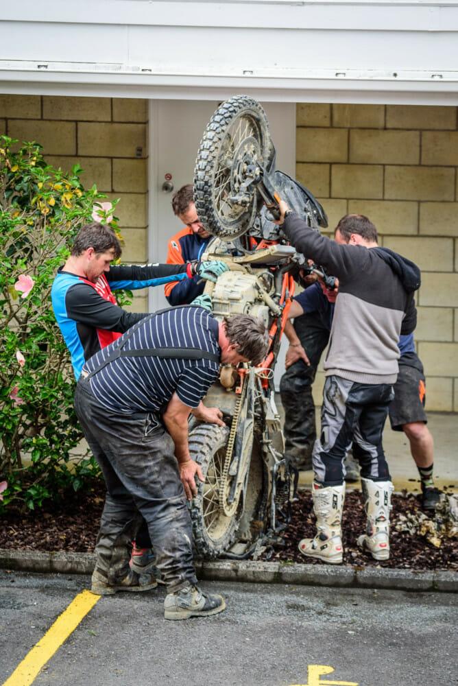 Repairing a bike at the KTM New Zealand Adventure Rallye