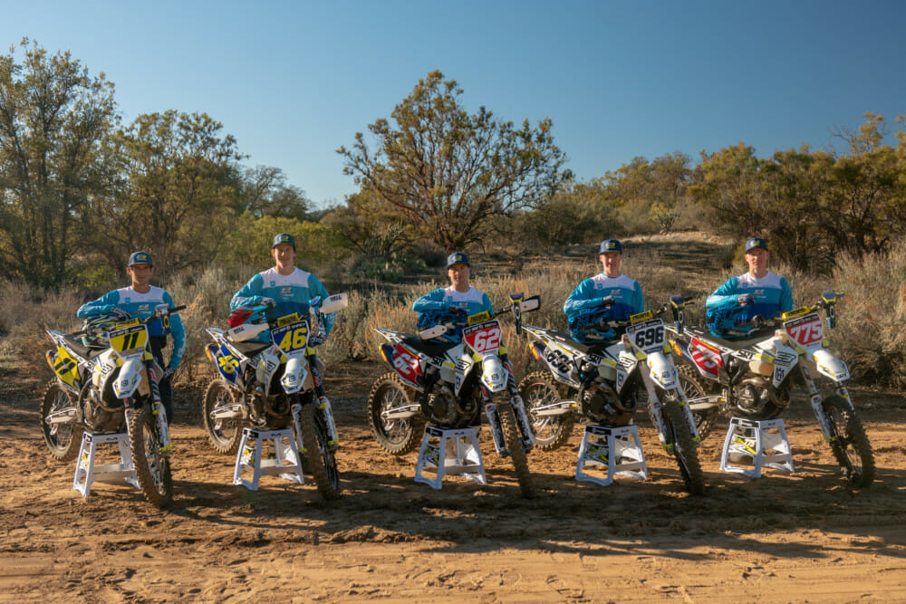 The 2019 3Bros / SRT / Husqvarna Racing team riders pose with their motorcycles.