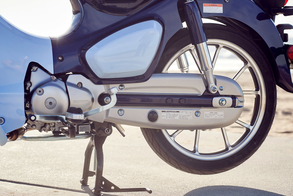 The chain on the 2019 Honda C125 Super Cub is fully enclosed.