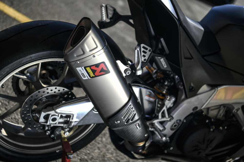 The 2019 Aprilia RSV4 1100 Factory has a titanium Akrapovic muffler.