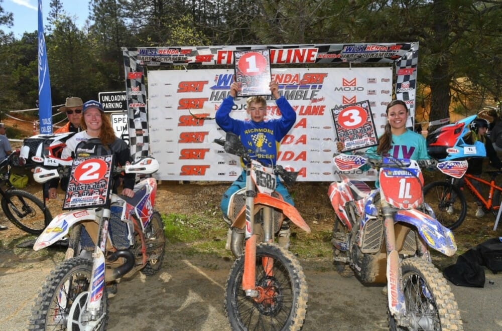 Ricky Kinney tops the podium for the overall race 2 win on Sunday next to Women Pro racers, Chidester Transport backed Sharon Mowell and Factory Beta's Morgan Tanke at the Shasta Dam Grand Prix.