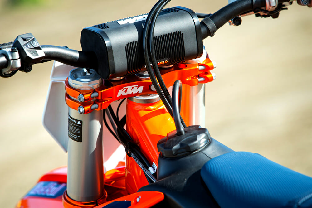 The 2019 KTM 450 SX-F Factory Edition has orange anodized factory triple clamps.