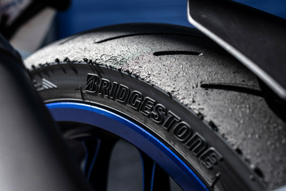More grooves mean better wet grip, but also gives less slippage under full load as the tire molds to the tarmac.