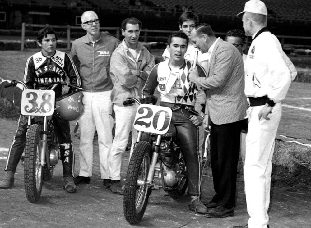 Gene Romero is seen here being interviewed by Roxy Rockwood at the Houston Astrodome in 1969 while his friend and fellow racer David Aldana looks on.