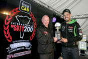 James Hillier (Quattro Plant Kawasaki) receives the Robert Dunlop Man of the Meeting award from fonaCAB International North West 200 in association with Nicholl Oils Event Director, Mervyn Whyte, after his 1st, 2nd and 3rd place finishes at this year's 90th anniversary races.