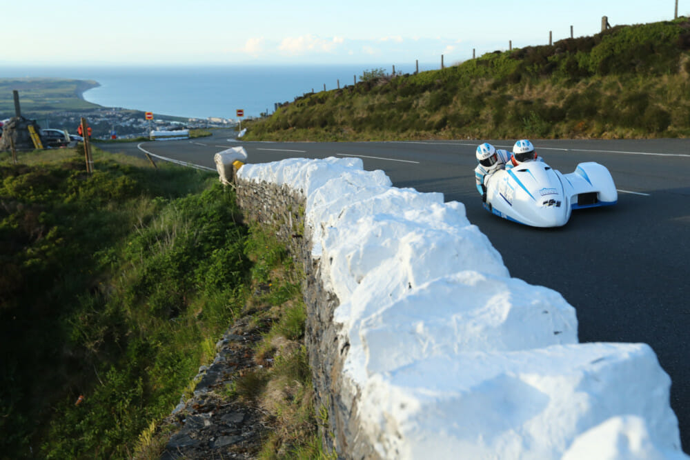 Newcomers Ryan and Callum Crowe laid down a stunning 109.76 mph lap on their 675cc Triumph.
