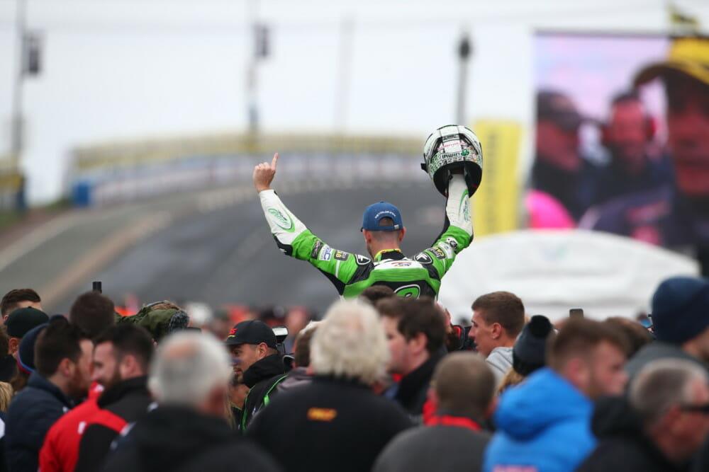 Glenn Irwin celebrates victory.