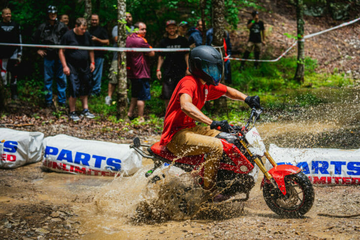 A rider splashing through the water at the 2019 Barber Small Bore event.