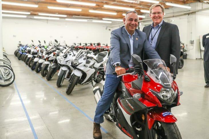Congressman Gil Cisneros astride a Suzuki GSX250R motorcycle alongside Suzuki Motor of America, Inc. Vice President, Motorcycle/ATV Sales and Marketing, Kerry Graeber.