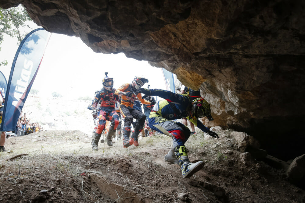 Riders race on foot to their bikes located in a cave - © Future7Media