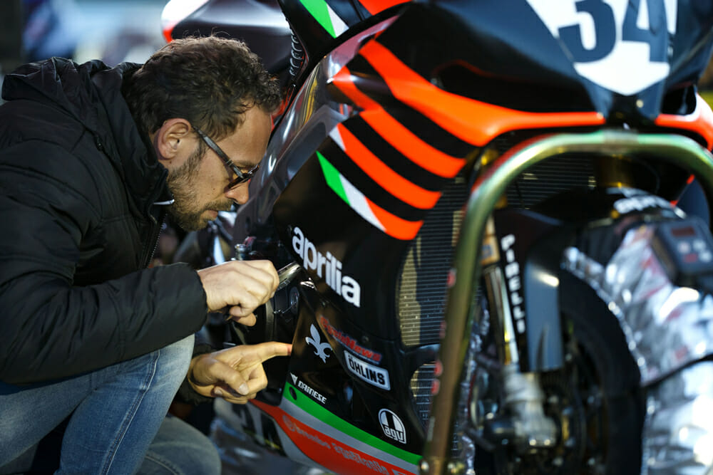 Nicola Marcato inspects the Aprilia during Day Three of practice. His expertise in mapping the Aprilia made all the difference in overall performance.