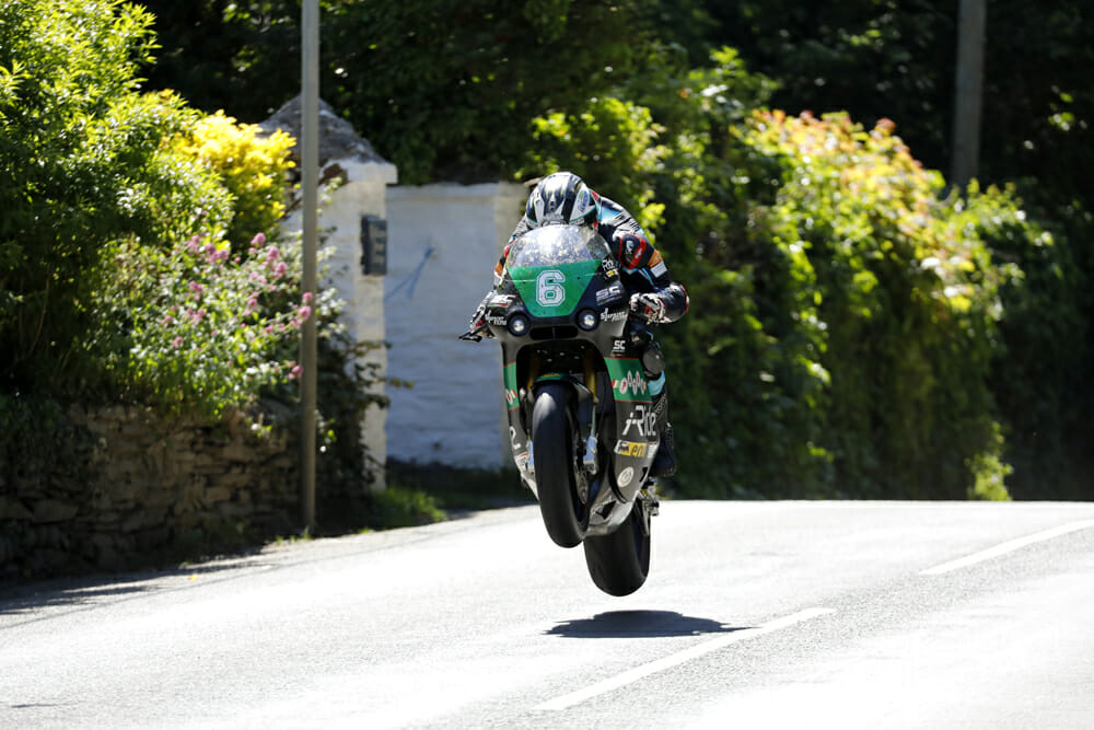 Michael Dunlop goes 'full send' on the Paton on his way to the 2018 Lightweight TT win.