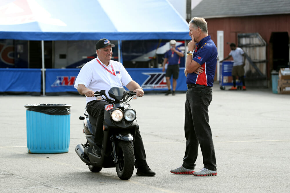 Chuck Aksland (left) and MotoAmerica Physical Therapist James Buskirk in a discussion.