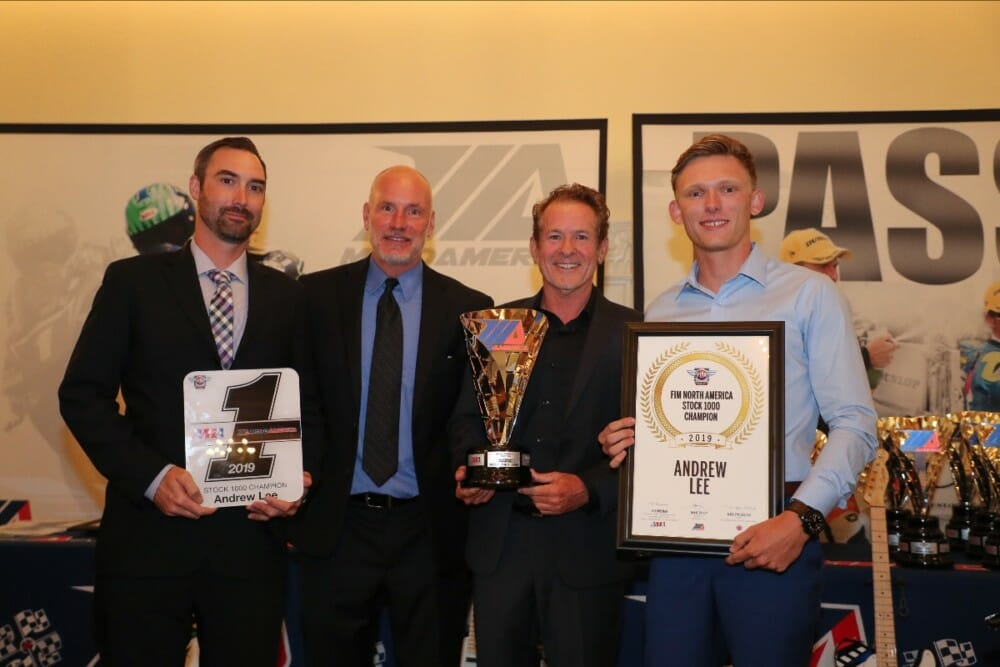 (From left to right) Crew chief Derek Keyes, Massey, MotoAmerica Communications Manager Paul Carruthers and Andrew Lee hold Lee's MotoAmerica Stock 1000 Championship awards.|Photo by Brian J. Nelson