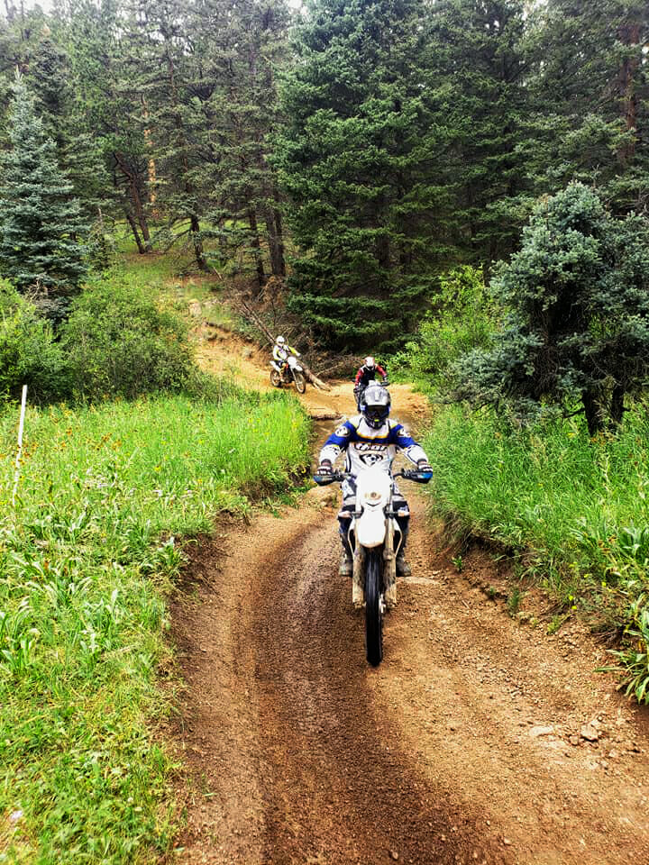 Gary Surdyke, Hoess, and Erik Nijkamp enjoy a casual trail ride in the Colorado Rockies.