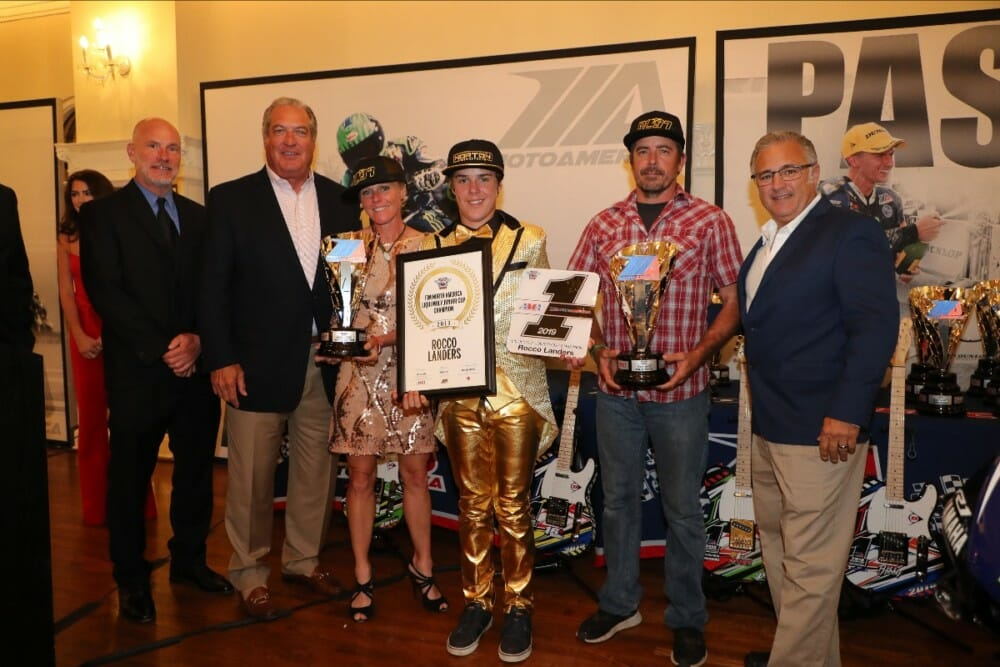 (From left to right) Massey, MotoAmerica Partner Richard Varner, Jamie Landers, Rocco Landers, Stoney Landers and Liqui Moly's Vinny Russo celebrate Rocco's Liqui Moly Junior Cup title.|Photo by Brian J. Nelson