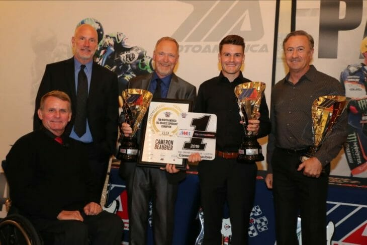 (From left to right) MotoAmerica President Wayne Rainey, AMA Chief Operating Officer Jeff Massey, crew chief Rick Hobbs, Cameron Beaubier and team manager Tom Halverson celebrate Beaubier's Superbike Championship at the Night of Champions.|Photo by Brian J. Nelson
