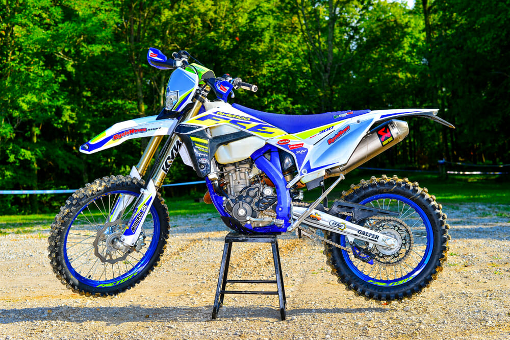 The 2020 Sherco 300 SEF is nicely trimmed with a Selle Dalla Valle gripper seat cover, blue Excel rims, steel rear sprocket, dual compound grips, and a Neken bar pad.