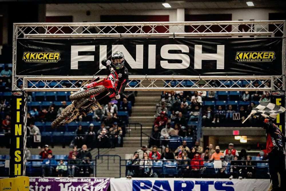 Kyle Peters taking the checkered flag and the win in the Arenacross 450 Pro Sport Main Event.