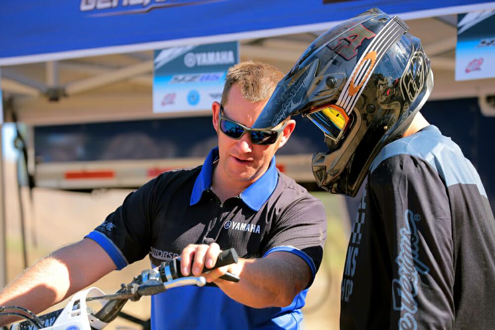 Jason Raines gets a rider set up for a demo ride.