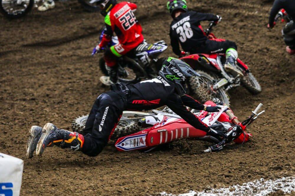 Phoenix Racing Team Honda rider Jace Owen crashes during Round Nine 250 Pro Sport Main.