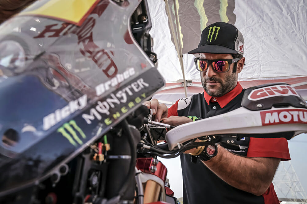 Kendall Norman prepares Brabec's CRF450 Rally for another day of Dakar.